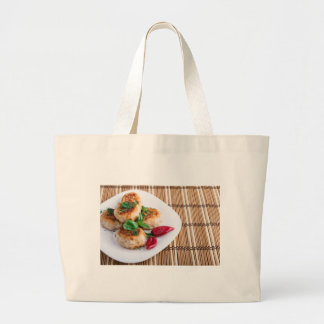 Fried meatballs of minced chicken on a stripe back large tote bag