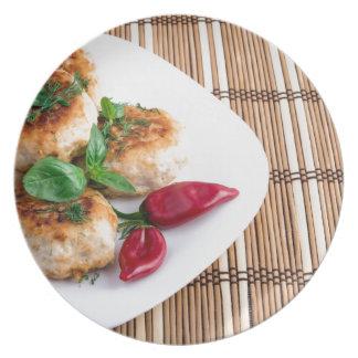 Fried meatballs of minced chicken on a stripe back plate