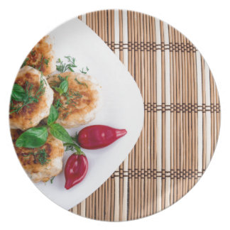 Fried meatballs of minced chicken with red pepper melamine plate