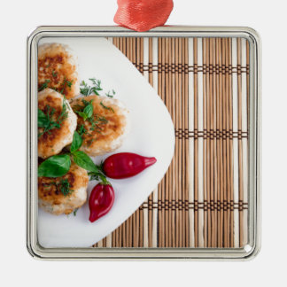 Fried meatballs of minced chicken with red pepper metal ornament