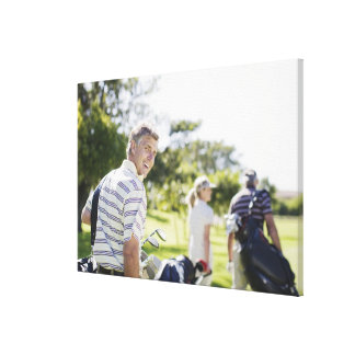 Friends carrying golf bags canvas print