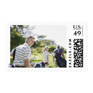 Friends carrying golf bags postage