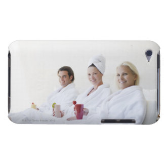 Friends drinking fruit smoothies at spa barely there iPod cover