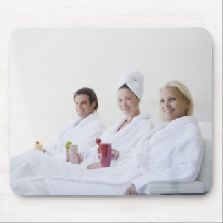 Friends drinking fruit smoothies at spa mouse pad