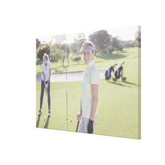 Friends playing golf canvas print