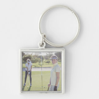 Friends playing golf key chains