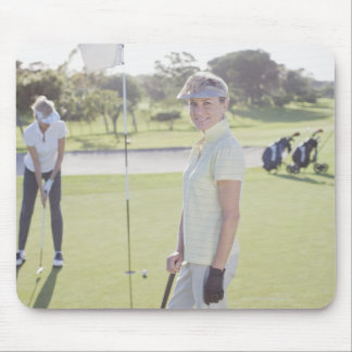 Friends playing golf mouse pad