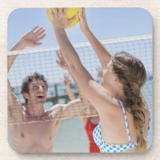 Friends playing volleyball on beach drink coaster