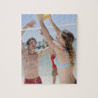 Friends playing volleyball on beach jigsaw puzzle