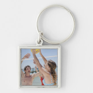 Friends playing volleyball on beach key chain