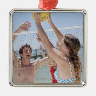 Friends playing volleyball on beach ornaments