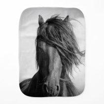 Friesian stallion in the wind. burp cloth