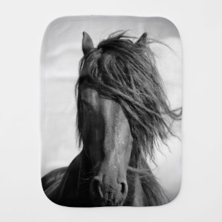 Friesian stallion in the wind. burp cloth