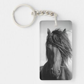 Friesian stallion in the wind. keychain