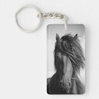 Friesian stallion in the wind. keychain