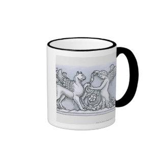 Frieze depicting mythical winged animal and ringer coffee mug