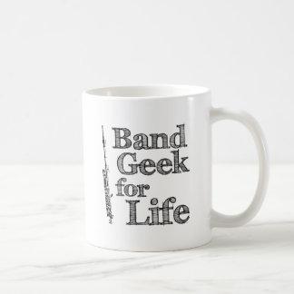 Friki de flautín de la banda taza