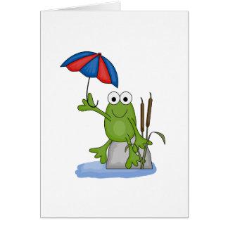 froggy que se sienta debajo del paraguas felicitacion