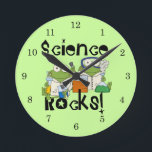"Frogs Science Rocks Round Clock<br><div class=""desc"">Two frogs with lab coats and safety goggles doing lab experiments on Science Rocks T-shirts,  hoodies,  buttons,  cards,  mugs,  magnets,  keychains,  journals,  mousepads,  and other Science Rocks apparel and gifts that are sure to get a few laughs and second looks!</div>"