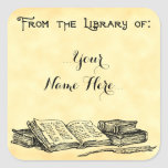 """From the Library of Vintage Books Custom Bookplate<br><div class=""""desc"""">This custom bookplate has room for your name in script letters and art of vintage books and an old feather writing quill in antique etched art on a faux parchment background, The top reads From the Library of in old English gothic letters. You can customize this sticker to change fonts,...</div>"""