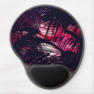 Frondas púrpuras y rojas tropicales de la palma de alfombrilla gel