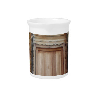 Front view of a wooden mountain cabin drink pitchers