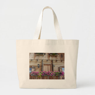 Front view of a wooden mountain cabin large tote bag