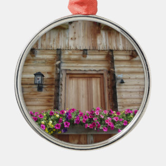 Front view of a wooden mountain cabin metal ornament