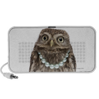 Front view of a Young Little Owl wearing a Speaker System