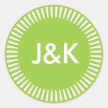 Frontera radiante de dos iniciales, verde del pegatina redonda