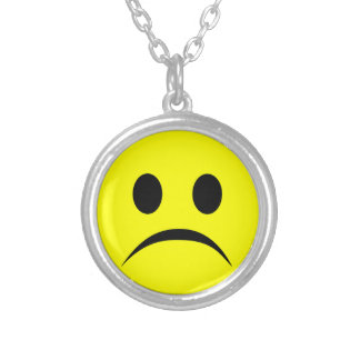 Frowning smiley silver plated necklace