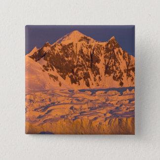 frozen glacial mountain landscape along the button