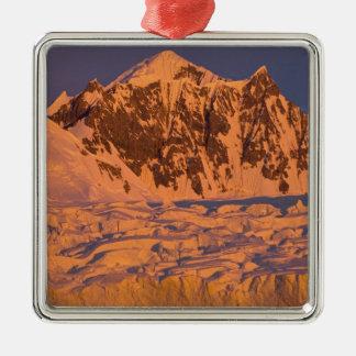 frozen glacial mountain landscape along the metal ornament