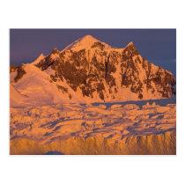 frozen glacial mountain landscape along the postcard