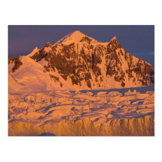 frozen glacial mountain landscape along the postcard