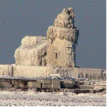 "Frozen Lighthouse, Cleveland Statuette<br><div class=""desc"">December 2010,  the lighthouse in Cleveland Harbor froze- this is a memory of that moment. Rare occasion caught in a photo and now in sculpture.</div>"