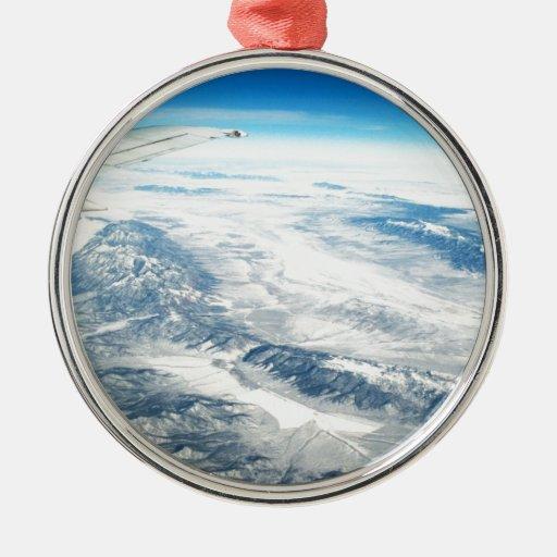 Frozen mountain tops round metal christmas ornament zazzle