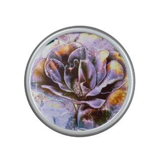 Frozen purple rose flowers in winter bluetooth speaker