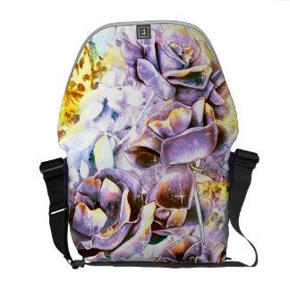 Frozen purple rose flowers in winter messenger bag
