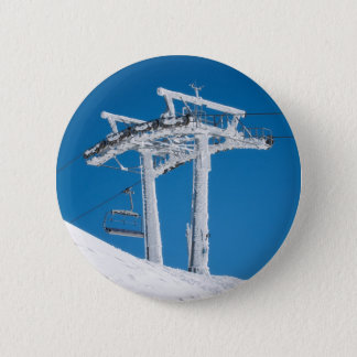 Frozen ski lift button