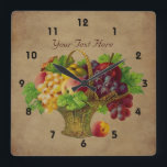 """Fruit Basket Vintage Art Square Wall Clock<br><div class=""""desc"""">Delightful wicker fruit basket filled with apples, grapes, and peaches vintage art wall clock. Replace your text in the template, or delete for no text. Click on Customize to add text and change font size, style, and color. Contact me with any design questions or requests. This image is available on...</div>"""