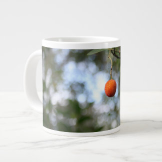 Fruit of the tree of madroño in the mountain range giant coffee mug