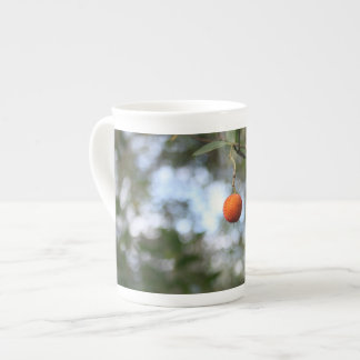 Fruit of the tree of madroño in the mountain range tea cup