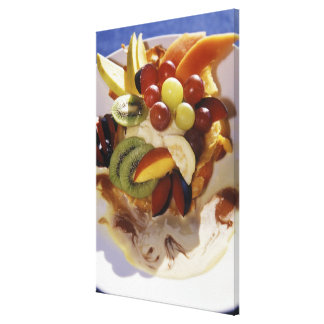 Fruit salad with ice cream. canvas print