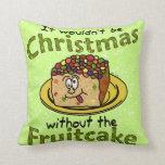 Fruitcake divertido del dibujo animado del navidad almohada