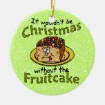 Fruitcake divertido del dibujo animado del navidad adorno redondo de cerámica