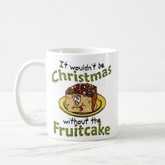 Fruitcake divertido del dibujo animado del navidad taza