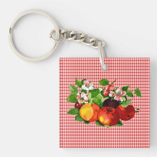 Fruta en la tela escocesa roja llaveros