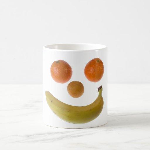 Fruta sonriente taza de café