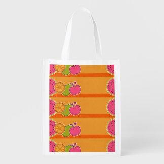 Frutas frescas anaranjadas bolsas para la compra